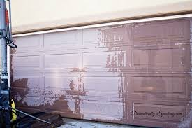 our faded garage door getting cleaned before the gel stain