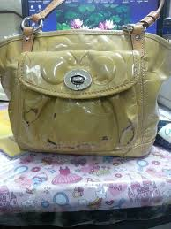 i have a yellow coach patent leather tote bag can someone please help me with how to remove the black stains thank you