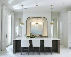 gold pendant light kitchen white and gold pendants over dark stained kitchen island with white stools