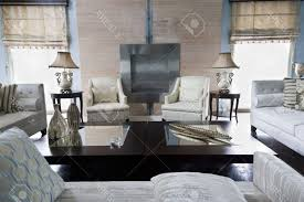 living room white wall paint color two toned leather sofa paired white sofa bedroom divider wite