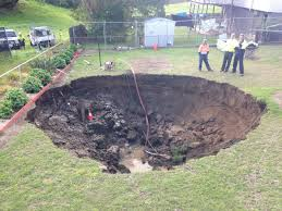 large crater formed from the aussies in the backyard the funnel is filled with water appeared in the back yard of a house in the australian city of ispwich
