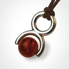 rolling stone pendant in 925 sterling silver and amber by the jewellery collection for children mikado