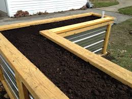self watering garden bed. Contemporary Bed Some Kind Of Raised Gardenflower Bed In Our Backyard I Wanted  Something Tall But Affordable Shae Low Maintenance Here Is The Almost Finished And Self Watering Garden Bed T