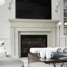 light gray limestone fireplace with tv niche