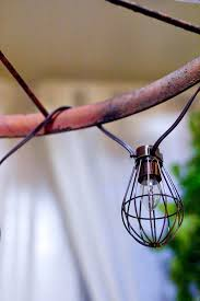 at this point hang the chandelier frame from that hook and adjust your chains and s hooks until everything is even and at the length you desire
