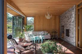 ... Stylish sunroom with folding glass doors and stone and wood walls  [From: Dancing Cameras