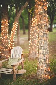 backyard string lighting. create a romantic spot by twisting string of white lights around cluster trees in your backyard not only will this an enchanting place to sit lighting i