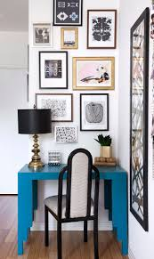 images hollywood regency pinterest furniture: contemporary hollywood regency work space a collection of artwork hangs above a blue desk
