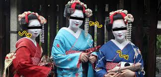 also look at the 3rd one she has a camera with her maiko are not allowed to use any electronics while working