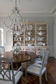 formal dining room ideas with wrought iron crystal chandelier and traditional round dining table