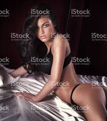Sexy Brunette  Counter Strike  Source   GUIs   Menu Backgrounds     Beautiful and sexy brunette girl on dark Stock Images