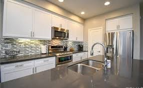 temecula photo 11 of 58 kitchen with quartz countertops large island and stainless steel appliances