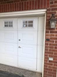 this garage door that has a regular door inside it