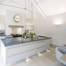 kitchen diner lighting. Kitchen With Under Island Unit Lights, Neutral Stone Flooring And White Leather Chairs Diner Lighting G
