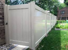 Image Fence Installation Tan Pvc Privacy Fence Paramount Fence Paramount Fence Vinyl Fence Installation In Michigan