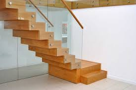 Amazing Hardwood Natural Polished Floating Stairs With Glass Banister  Wooden Handle In Modern White Interior Decors With Minimalist Designs