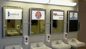 public bathroom mirror. These Stadium Bathrooms Have Digital Mirror Displays That Feature Game Stats Or Advertisements When A Patron Approaches. Public Bathroom D