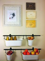 Use the IKEA Fintorp to make hanging storage. It's a great solution for  small kitchens