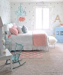 we love how the blue hanging chandelier rocking chair and dresser all perfectly match in this girls bedroom