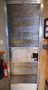 What we've done is attach a piece of quilted reflective insulation (which  comes in 2' widths, exactly the same as most RV doors) and attach it to the  ...