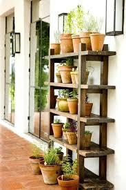 herbs in terracotta backyard secret garden wood shelf and outdoor shelving ideas shed outdoor garden shelves