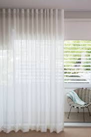 best 25 ceiling mounted curtain track ideas on stunning sheer white linen curtains overlaying sleek helioscreen bloc out roller blinds