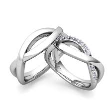 his and hers matching wedding band sets. this gold matching wedding ring set showcases brilliant diamonds in her and an infinity band with shiny finish as his hers sets
