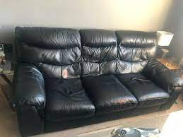 large black 3 leather seater sofa in