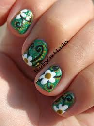 Green polish base with white flower and vines nail art design ...