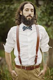 picture of ocher pants a white shirt brown leather suspenders and a matching belt a colorful bow tie