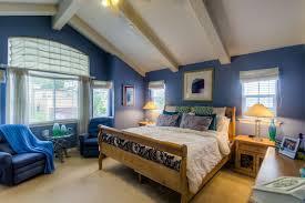Blue master bedroom design Cobalt Blue Cottage Style Master Bedroom With Beam Ceiling Blue Walls And Beige Carpet Flooring Home Stratosphere 20 Blue Master Bedroom Ideas For 2019