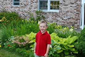 how to design a garden. My Son In Front Of Our Zone 5 Garden: Hostas, Astilbe And Daylilies Grow How To Design A Garden