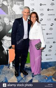 Damon Hill and Susan George attending the Music Industry Trusts Award Stock  Photo - Alamy
