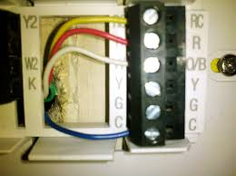 how to add c wire to thermostat the top of the thermostat and base plate are curved the picture didn t come out quite as straight but you can see how the 4 wires attach to the