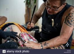 Side View Of Hawaiian Tattoo Artist Making Tattoo Oahu Hawaii