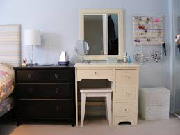 bedroom cream wooden dressing table with drawer and stool on grey rug connected by square