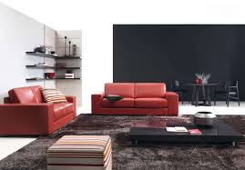 decorating ideas living room with red leather sofa and black wood coffee table and using corner wall shelf