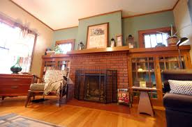 enchanting image of living room decoration using sage green living room wall paint including brown brick fireplace surround and arts and crafts fireplace