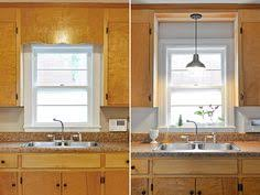lighting above kitchen sink. remove decorative wood over kitchen sink and install pendant fixture instead of pot light thatu0027s there lighting above o