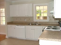 top white kitchen cabinets with concrete countertops kitchen