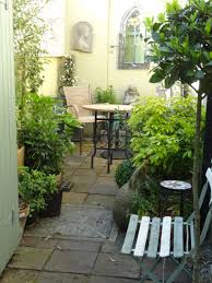 Courtyard Plants Design Make The Most Of A Tiny City Courtyard With Tall Lush Plants