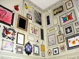 the artist hung some of her children s art painted the frames with black craft paint and used sharpies to do the detail work i desperately want this done
