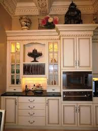 adorable white finish antique kitchen cabinet with lovely decor