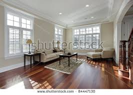 hardwood living room. living room in luxury home with cherry wood flooring hardwood