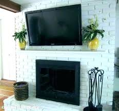hanging tv above fireplace installing over fireplace