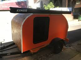 picture of four person teardrop camper with co