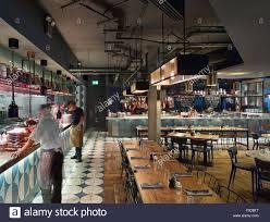 restaurant open kitchen. Open Kitchen, Servery And Restaurant Seating. Jamie\u0027s Italian, More London, United Kingdom. Architect: Stiff + Trevillio Kitchen S