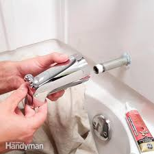 tub spout leaking when water is off cutaway photos show how to replace the three most tub spout leaking
