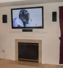above fireplace tv installation