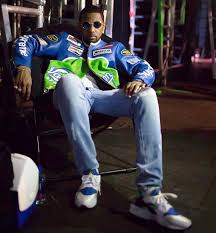 fabolous wears a supreme x vanson leather jacket and nike air huarache sneakers